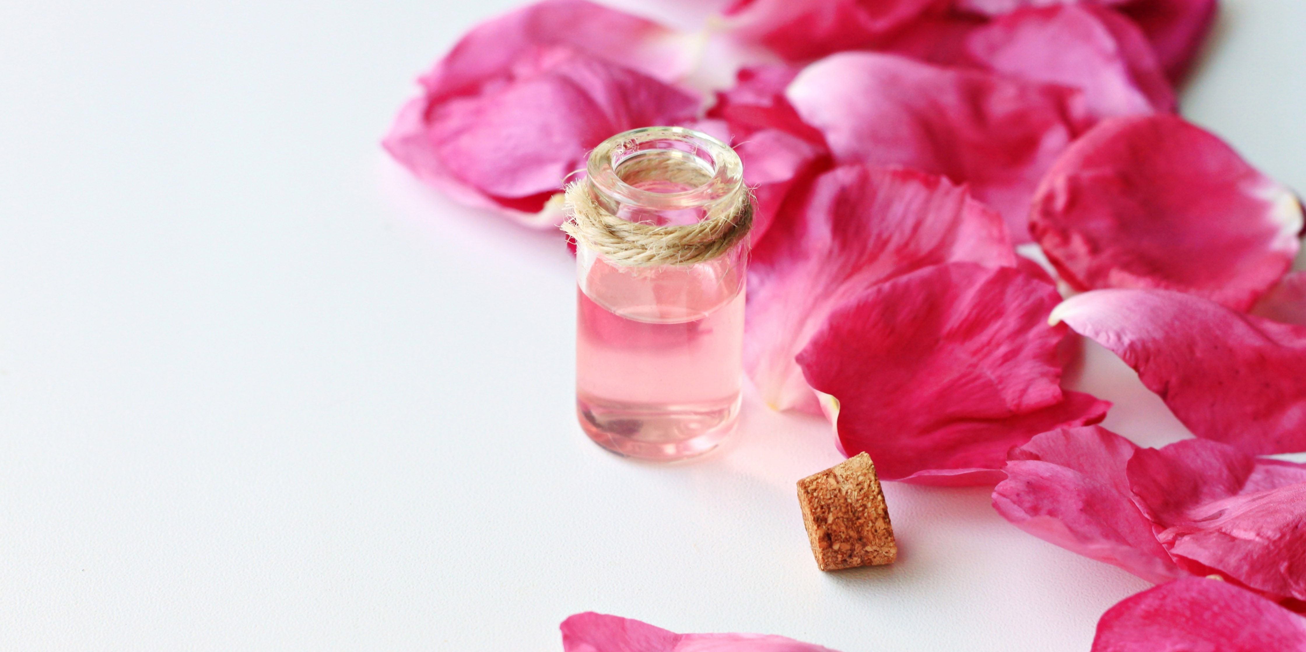 pink aromatic fluid oil rose petals, anti-stress treatment with essential oils